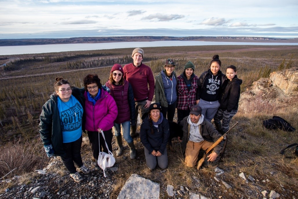 Emerging Leaders group posing for a photo on a rock in the north.