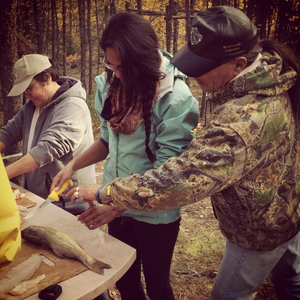 In 'building the skills' Chief Baker teaches trip participant Andi Sharma how to filet a fish