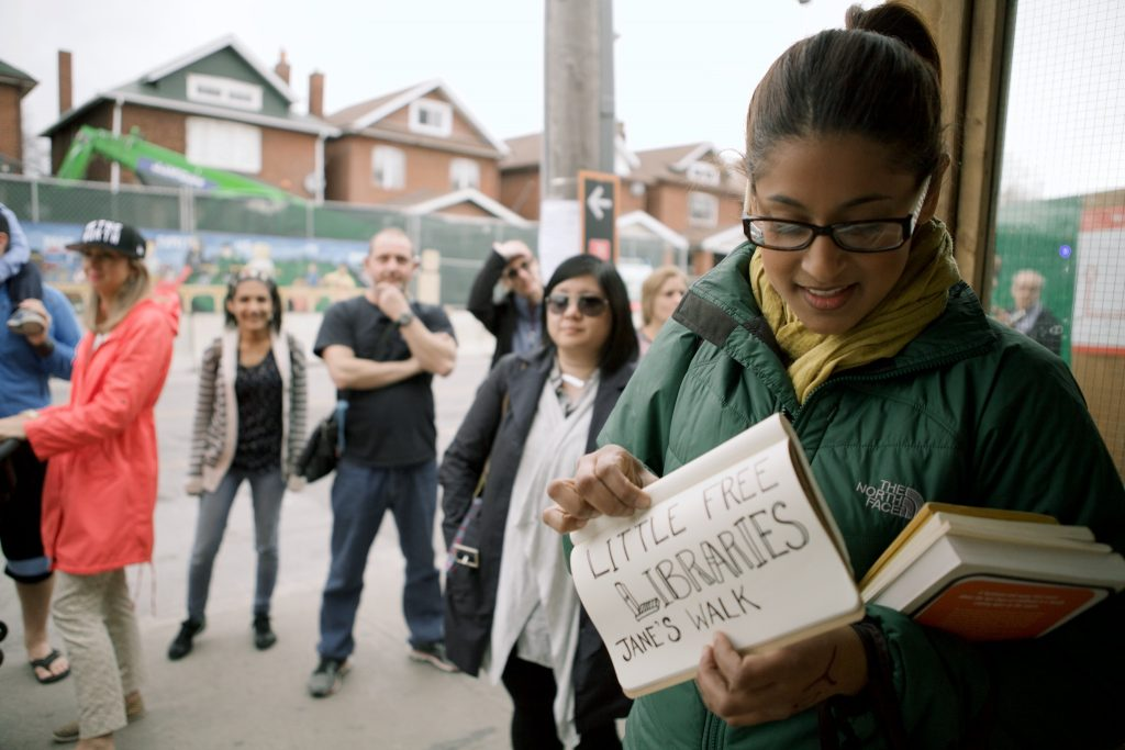 Jane's Walk Global Director Denise Pinto leading Little Free Libraries: An Impromptu Reading Walk With Neighbours, Jane's Walk Festival 2016, Toronto. Photo: Margaux Yiu.