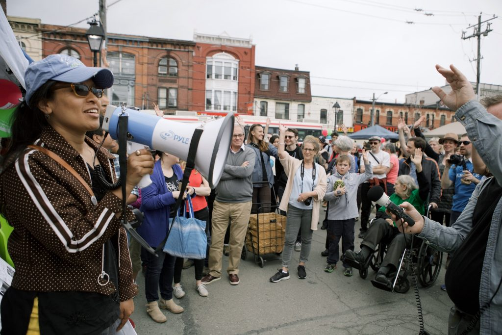 The Tibetan Experience in a Gentrifying Parkdale, Jane's Walk Festival 2016, Toronto. The walk focused on the growing Tibetan community in Parkdale and highlighted how Tibetan residents and businesses are collaborating and playing leadership roles in community organizations, tenant groups, and associations responding to the escalating gentrification of the area. Photo: Margaux Yiu.