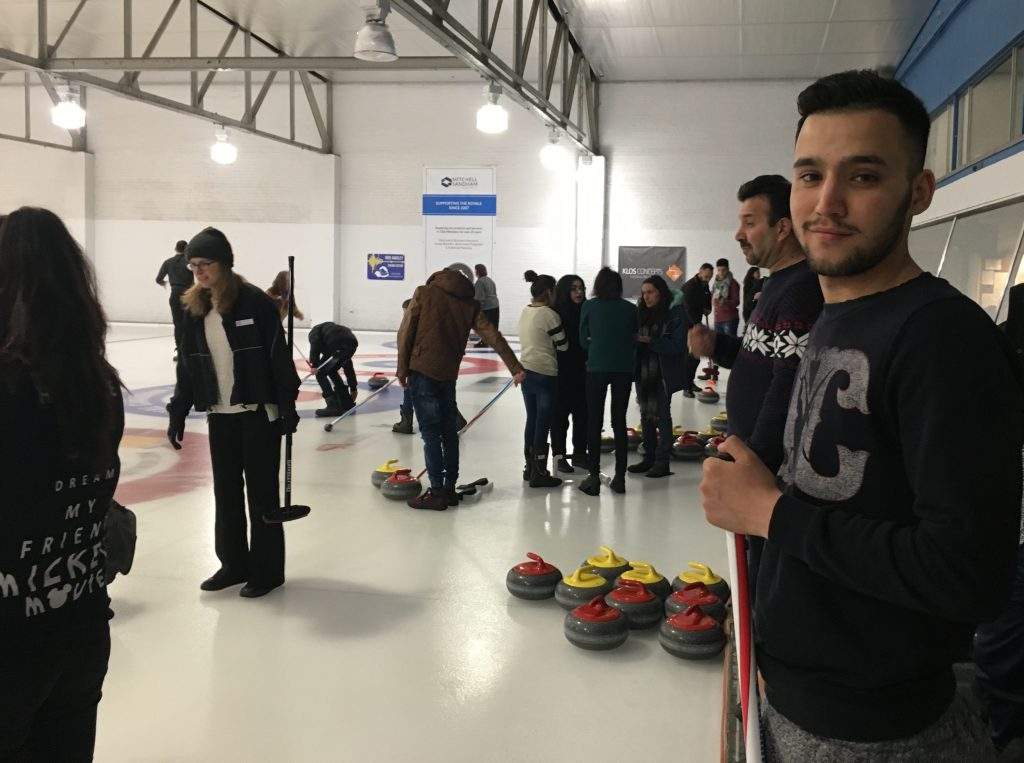 Refugee Newcomers Learn to Curl at the Royal Canadian Curling Club / Photo: Anna Hill for Together Project