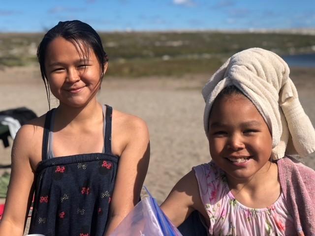 two girls near a lake