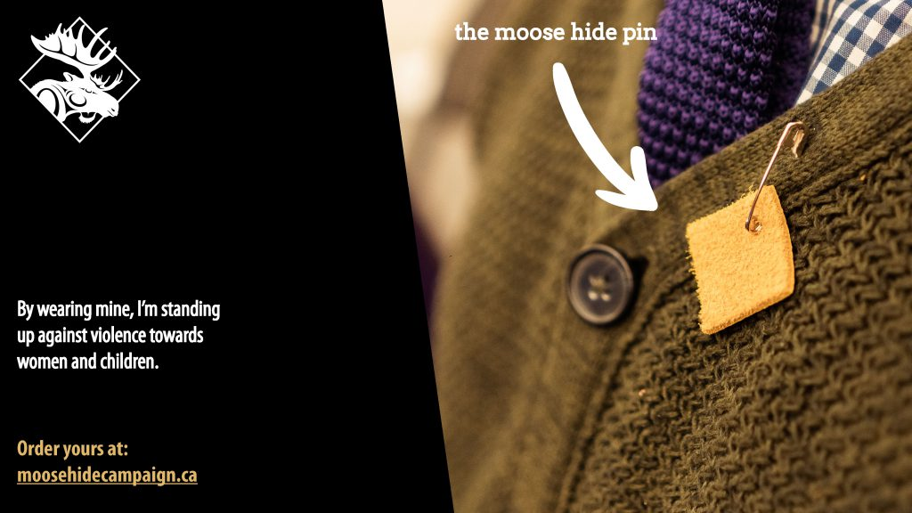 moose hide square pin on sweater graphic