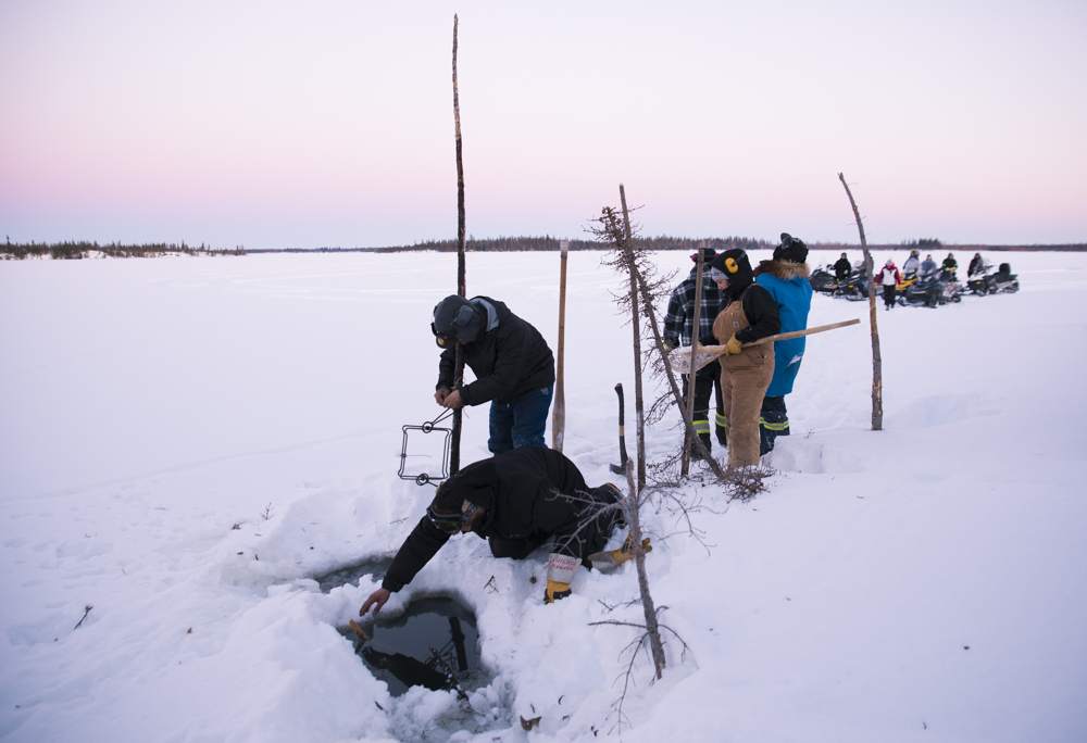 A group of people ice fishing